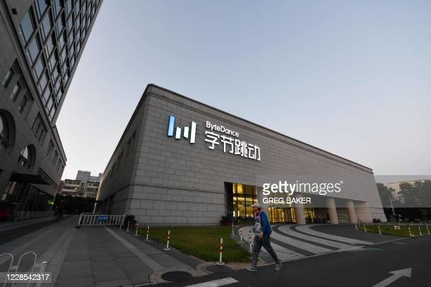 Man walks past the headquarters of ByteDance, the parent company of video sharing app TikTok, in Beijing on September 16, 2020. - Silicon Valley tech...