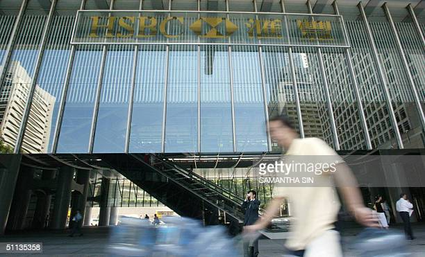 Man walks past the Hong Kong and Shanghai Bank Cooperation in Hong Kong headquarter office 02 August 2004. Global banking giant HSBC Holdings said 02...