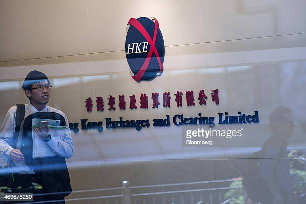 A man walks past the Hong Kong Exchanges Clearing Ltd logo displayed at the stock exchange in Hong Kong China on Tuesday April 14 2015 Chinese stocks...