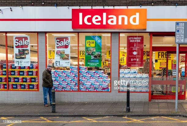 Man walks past the Iceland supermarket in Wales. Due to rising levels of covid infection - and the high prevalence of a more infectious variant of...