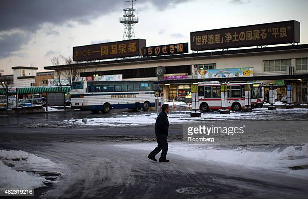 A man walks past the Ichinoseki train station in Ichinoseki Iwate prefecture Japan on Sunday Jan 18 2015 Japan plans a record budget for next fiscal...