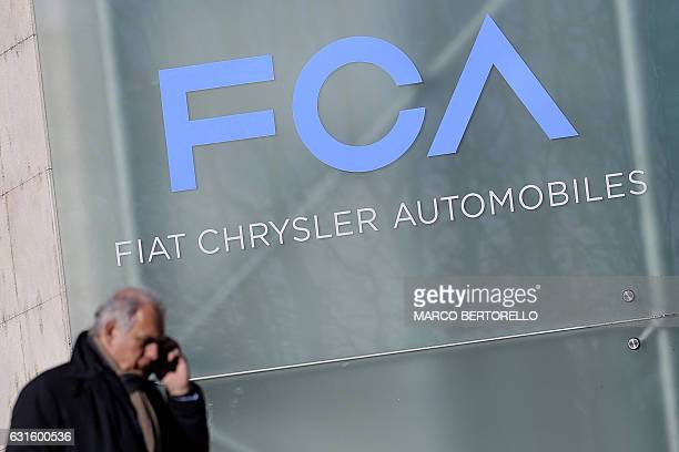 A man walks past the logo of Fiat Chrysler Automobiles at the Fiat Mirafiori car plant on January 13 2017 in Turin northern Italy The United States...
