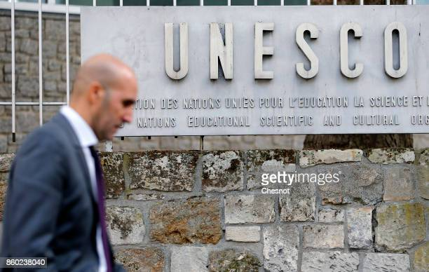A man walks past the logo of the United Nations Educational Scientific and Cultural Organization on October 11 2017 in Paris France From this Monday...
