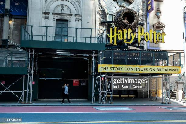 A man walks past the Lyric Theatre where Harry Potter and the Cursed Child has been closed as Broadway remains dark on Sunday afternoon The streets...