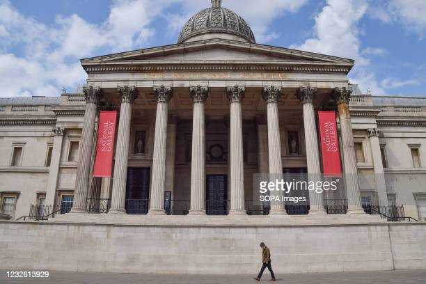 Man walks past The National Gallery in Trafalgar Square, London. Museums have been closed for much of the time since the coronavirus pandemic began...