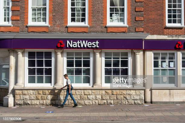 Man walks past the NatWest bank in Orpington, London.