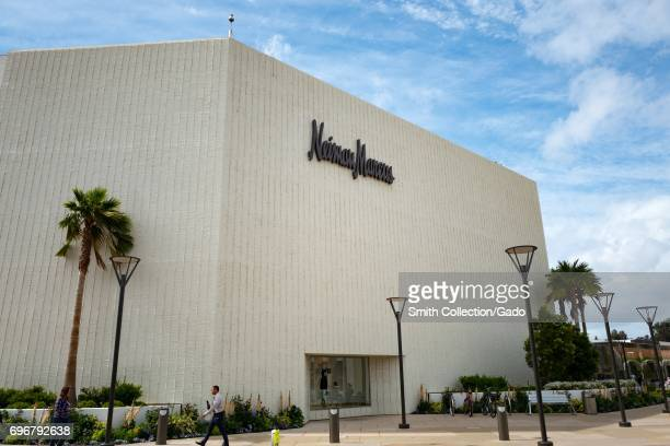 A man walks past the Neiman Marcus department store on a sunny day at the Stanford Shopping Center an upscale outdoor shopping mall in the Silicon...