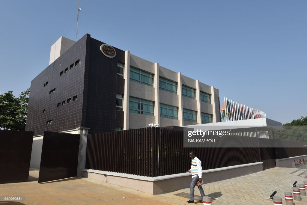 A man walks past the new headquarters of the International Cacao Organization (ICCO) in Abidjan on March 13, 2017, ahead of a visit by the ICCO chairperson
