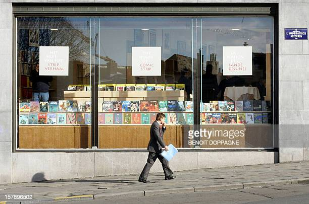 A man walks past the newly opened 'Maison de la Bande Dessinee' 01 March 2006 in Brussels