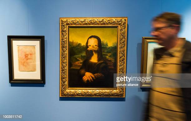 A man walks past the oil painting 'Mona Lisa' as duck at the special exhibition 'DUCKOMENTA' in the Archäologisches Museum Hamburg Germany 07 June...