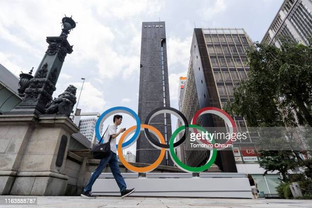 A man walks past the Olympic rings in the Nihombashi district on July 24 2019 in Tokyo Japan
