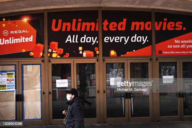 Man walks past the Regal Cinemas in Times Square on March 24, 2021 in New York City. Regal Cinemas parent company, Cineworld Group, announced on...