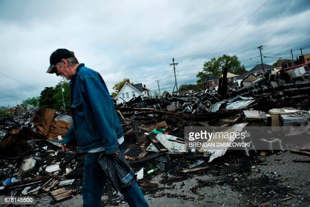 Man walks past the remains of a building on April 19, 2017 in Huntington, West Virginia. Huntington, the city in the northwest corner of West...