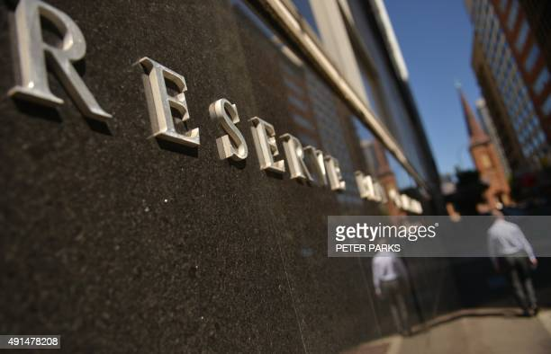 A man walks past the Reserve Bank of Australia in Sydney on October 6 2015 The Reserve Bank of Australia kept interest rates at a record low of 20...