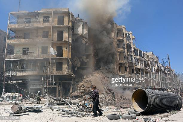 A man walks past the rubble of a building following reported shelling by Syrian government forces in the Bab alHadid neighbourhood of the northern...