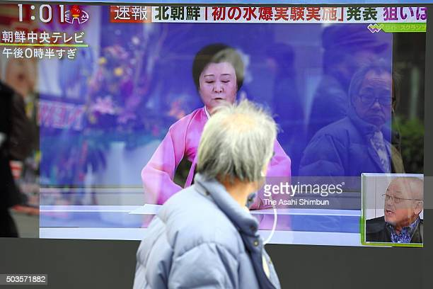 A man walks past the screen broadcasting the news of the North Korea's hydrogen bomb test on January 6 2016 in Tokyo Japan The Korea Meteorological...