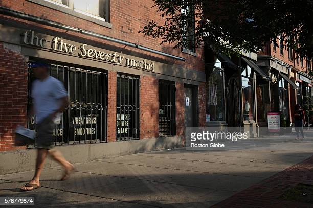 A man walks past the shuttered Five Seventy Market on Tremont Street in the South End of Boston The store has been frozen in time since owner Allen...