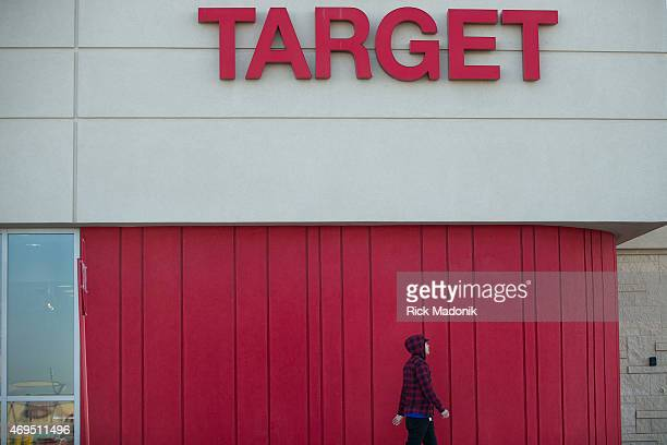 BRAMPTON APRIL 12 A man walks past the signage The Target store in Trinity Commons Mall in Brampton was to be the last Target to close its doors It...