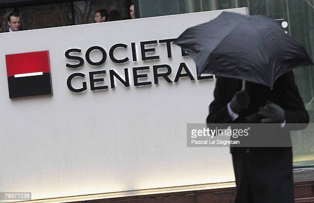 A man walks past the Societe Generale bank logo in front of the entrance of its headquarters on January 30 2008 in La Defense outside Paris France...