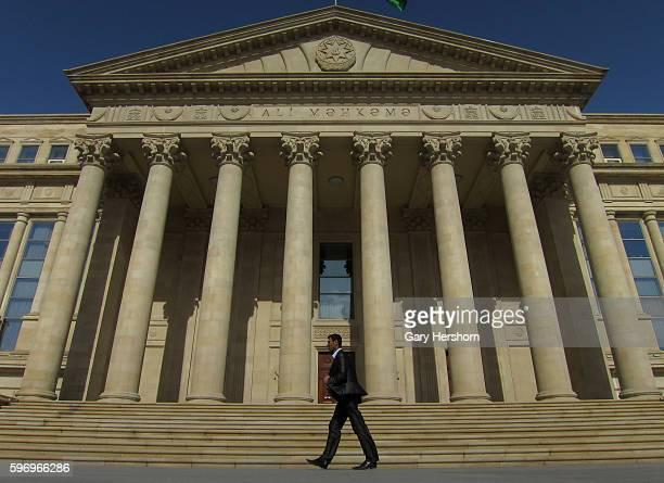 Man walks past the Supreme Court in Baku, Azerbaijan, May 3, 2014.