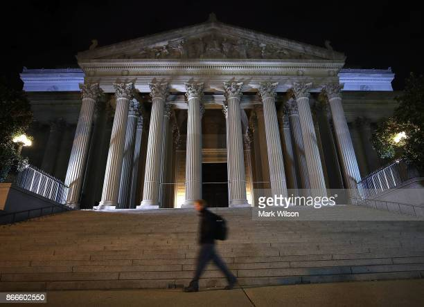 A man walks past the United States National Archives building on October 26 2017 in Washington DC Later today the National Archives will release more...
