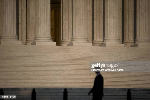 a man walks past the u.s. supreme court in washington, d.c. - democracy stock pictures, royalty-free photos & images