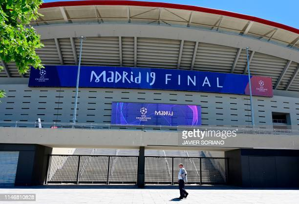 Man walks past the Wanda Metropolitan Stadium in Madrid on May 29, 2019 ahead of the UEFA Champions League final football match between Liverpool and...