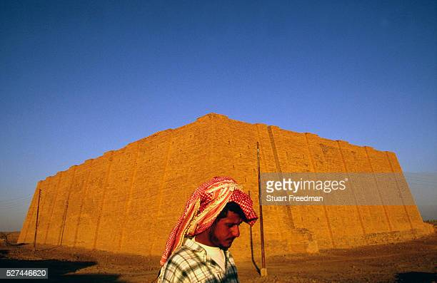A man walks past the ziggurat at Ur supoosedly the city of the prophet Abraham's birth Ur was a principal city of ancient Mesopotamia The Ziggurat...