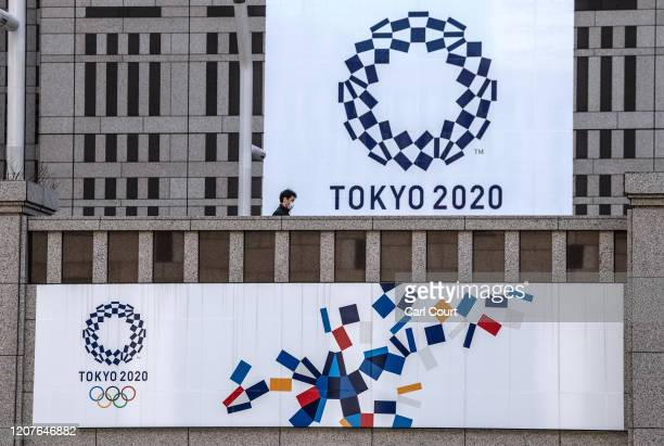 Man walks past Tokyo 2020 Olympics banners on March 19, 2020 in Tokyo, Japan. As Japanese and IOC officials continued to insist that the Games would...