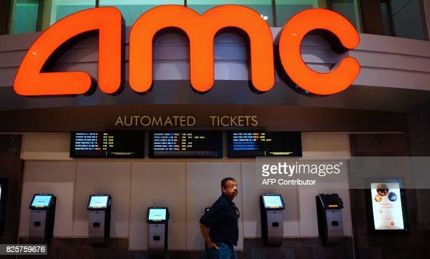 A man walks past vending machines for automated tickets at an AMC movie theater in Arcadia California on August 2 2017 AMC Entertainment Holdings the...