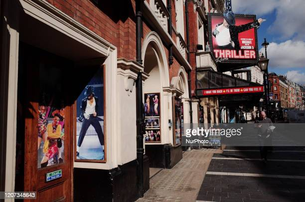 Man walks past West End theatres on an almost deserted Shaftesbury Avenue in London, England, on March 16, 2020. Around the country, as elsewhere in...