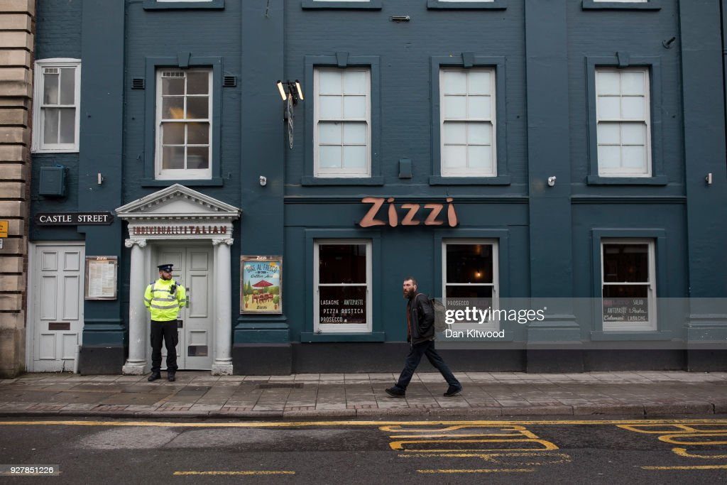 A man walks past Zizzi Restaurant in town centre, where a man and woman had been found unconscious two days previosly, on March 6, 2018 in Salisbury, England. The man is believed to be Sergei Skripal, 66, who was granted refuge in the UK following a 'spy swap' between the US and Russia in 2010. The couple remain critically ill after being exposed to an 'unknown substance'.