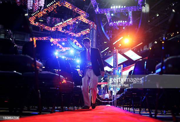 Man walks the floor before the start of the second day of the Republican National Convention at the Tampa Bay Times Forum on August 28, 2012 in...