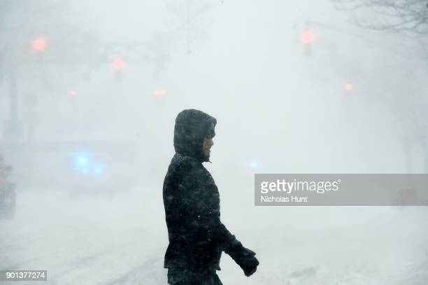 A man walks the streets during a massive winter storm on January 4 2018 in New York City As a major winter storm moves up the Northeast corridor New...