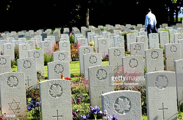 A man walks though the Canadian DDay cemetery on June 6 2003 in Northern France Today marks the 59 year anniversary of DDay The Canadian memorial...