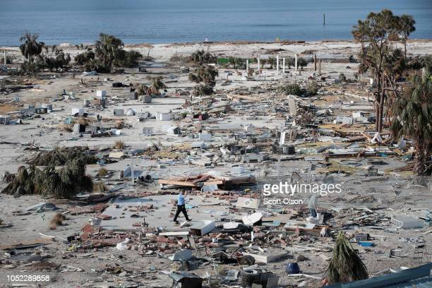 A man walks through a beachfront neighborhood that was decimated by Hurricane Michael on October 16 2018 in Mexico Beach Florida The neighborhood...