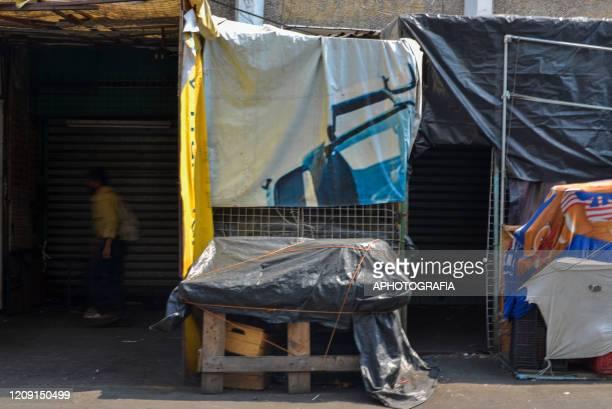 A man walks through a closed market on April 3 2020 in San Salvador El Salvador On March 21st President Nayib Bukele declared a 30day mandatory...