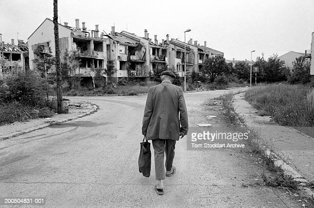 Bosnia Sarajevo September 1995 A man walks through a deserted street towards his house in a heavily bomb damaged area near Sarajevo airport During...