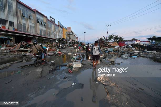 A man walks through a devastated area in Palu Indonesia's Central Sulawesi on October 1 after an earthquake and tsunami hit the area on September 28...