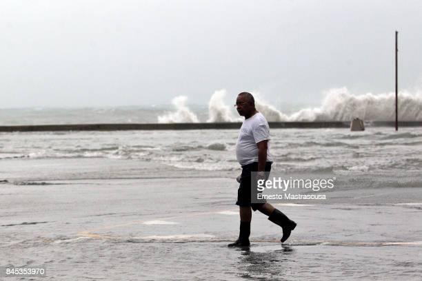 A man walks through a flooded street after Hurricane Irma barreled into Cuba on September 10 2017 in Havana Cuba
