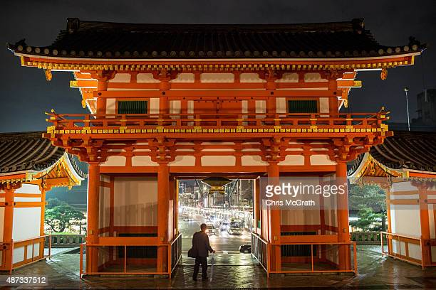 A man walks through a gate at the Yasaka Shrine on September 6 2015 in Kyoto Japan The famous city of Kyoto is going through a massive tourism boom...