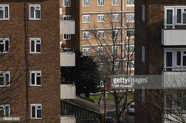 A man walks through a housing estate near Brixton on January 30 2013 in London England According to a report from independent analysts Oxford...