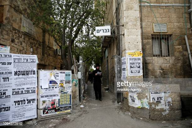A man walks through a narrowed street which was isolated for only men and indicated with banners and graffiti in Kerem Avraham neighbourhood of...