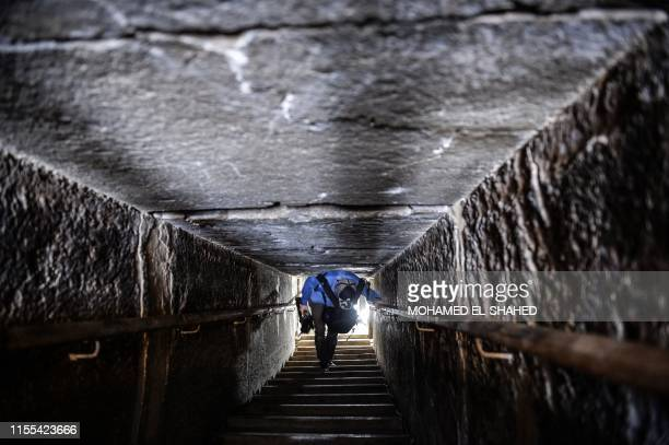 A man walks through a passage in the wellknown bent pyramid of King Snefru which had been closed to visitors since 1965 in Dahshur some 30 kilometres...