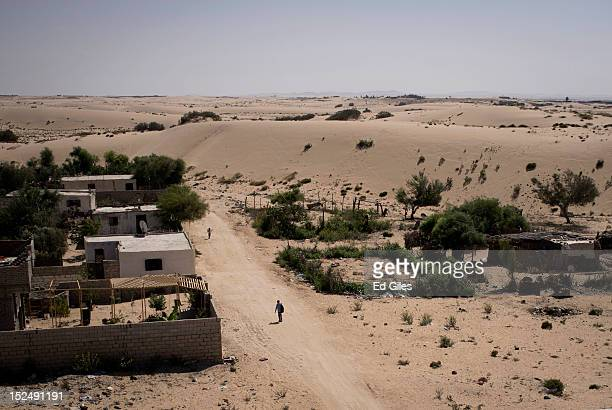 Man walks through a small street in Al Reesa, a suburb of El Arish, the capital of Egypt's restive North Sinai region, September 19, 2012. El Reesa,...