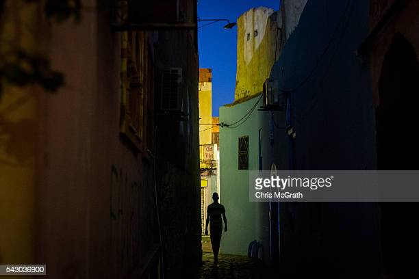 A man walks through a street in the old town tourist district on June 25 2016 in Sousse Tunisia Before the 2011 revolution tourism in Tunisia...