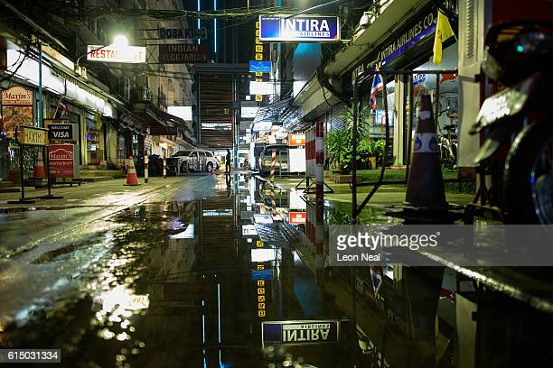 A man walks through a subdued district near Soi Cowboy on October 16 2016 in Bangkok Thailand Thailand's King Bhumibol Adulyadej the world's...