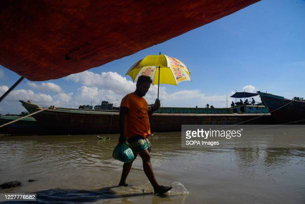 Man walks through a submerged road. The flood situation is worsening in Munshiganj. Due to the heavy rain, the water level of the Padma River has...