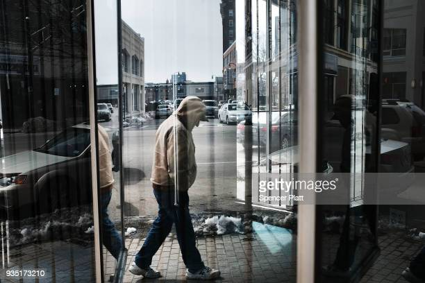 A man walks through an economically stressed section of the city on March 20 2018 in Worcester Massachusetts Worcester once a thriving manufacturing...