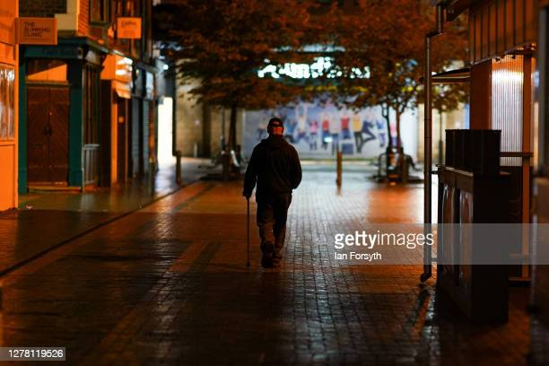 A man walks through an empty side street in Middlesbrough town centre on October 02 2020 in Middlesbrough England The mayor of Middlesbrough Andy...